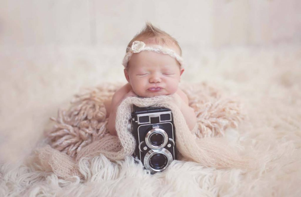 baby with camera photo